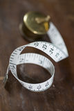 Measuring Tape on Wooden Surface Stock Photography