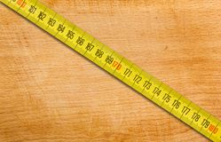 Measuring Tape on a Wooden Table Stock Photo