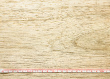 Measuring tape on wooden table Royalty Free Stock Image