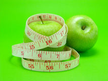 Measuring tape wrapped around apple Royalty Free Stock Images