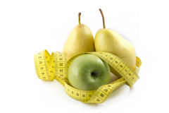 Measuring Tape Wrapped Around Apple And Pears Stock Image