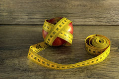Measuring tape wrapped around an apple Royalty Free Stock Images