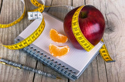 Measuring tape wrapped around a apple weight loss Royalty Free Stock Photos