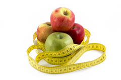 Measuring Tape Wrapped Around Apples Royalty Free Stock Image