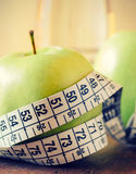 Measuring tape wrapped around a green apple Stock Photography