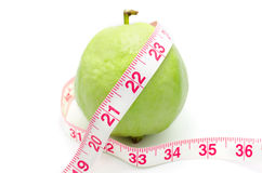 Measuring tape wrapped around a Guava Royalty Free Stock Photography