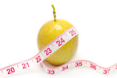 Measuring tape wrapped around a passion fruit Stock Photography