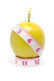 Measuring tape wrapped around a passion fruit Royalty Free Stock Image