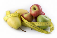 Measuring Tape Wrapped Around Pears And Apples Stock Image