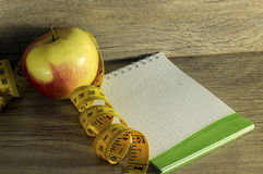 Measuring tape wrapped around a red apple Stock Image