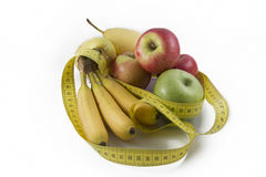Measuring Tape Wrapped Around Several Fresh Fruits Royalty Free Stock Image