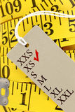 Measuring tape with xs size tag Royalty Free Stock Images