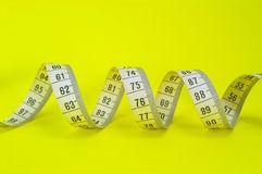 Measuring Tape on Yellow Stock Image