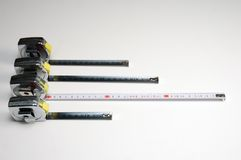 Measuring tapes. Over a light background from above Royalty Free Stock Image