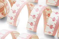 Measuring tapes. Close up of measuring tapes on white background Royalty Free Stock Photo