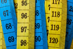 Measuring tapes. Closeup of the numbers on colorful measuring tapes Stock Image