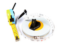 Measuring tapes. Lying over white background Royalty Free Stock Photo