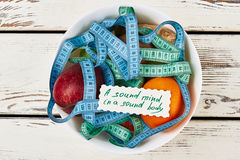 Measuring tapes and fruits. Good eating habits Royalty Free Stock Image