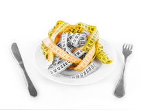 Measuring tapes on plate Stock Photos