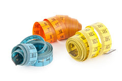 Measuring tapes. On white background Royalty Free Stock Photo