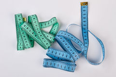 Measuring tapes on white background. Equipment for figure accuracy measurement Royalty Free Stock Photo