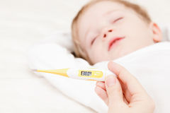 Measuring temperature for little boy Royalty Free Stock Photography