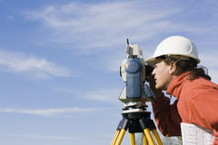 Measuring with theodolite royalty free stock image