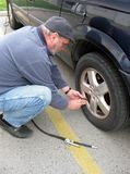 Measuring Tire Pressure Royalty Free Stock Photo