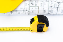 Measuring tool and architect`s plans Royalty Free Stock Photos