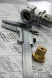 Measuring tool and workpiece. Rests with the drawing Royalty Free Stock Image