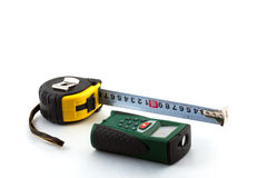 Measuring tools. Roulette and laser range finder on a white background Stock Image