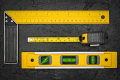 Measuring tools on a black metallic background Royalty Free Stock Images