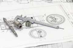 Measuring tools and blueprints. Stock Images