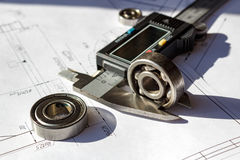 Measuring of the used ball bearings height by electronic caliper royalty free stock photos