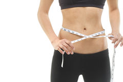 Measuring waist. An attractive female waist being measured. Photographed in studio Stock Images