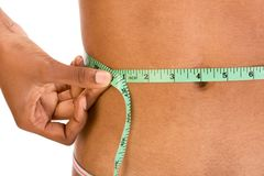 Measuring waist, close up of ethnic woman abdomen Royalty Free Stock Photo