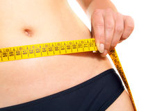 Measuring waist after dieting Royalty Free Stock Image