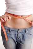 Measuring waist,losing weigh Royalty Free Stock Images