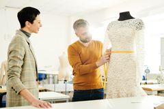 Measuring waist of new dress stock photo