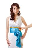 Measuring waist size. For wedding dress of a bride Royalty Free Stock Images