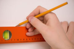 Measuring the wall. Royalty Free Stock Image