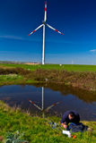 Measuring water quality. Scientist measuring  water quality near wind tribunes Stock Photos