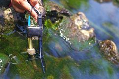 Measuring the water quality with probes. Researcher is measuring the water quality with probes Stock Photos