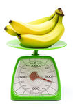 Measuring weight of the banana Royalty Free Stock Image