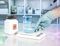 Weighting up hazardous chemical reagent Stock Image