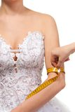 Measuring woman's arm size Royalty Free Stock Images