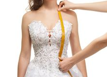 Measuring woman's shoulder to waist length Royalty Free Stock Images