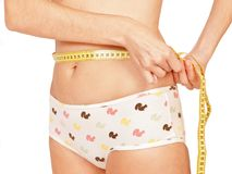 Measuring woman`s waist royalty free stock photography