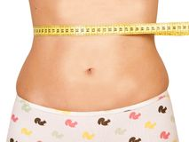 Measuring woman`s waist stock photo
