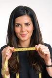 Measuring woman. Stock Photos